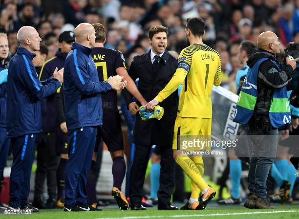 Mauricio Pochettino Manager of Tottenham Hotspur shakes hands with Hugo Lloris of Tottenham Hotspur after the UEFA Champions League group H match...