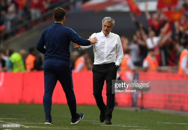 Mauricio Pochettino Manager of Tottenham Hotspur shakes hands with Jose Mourinho Manager of Manchester United after The Emirates FA Cup Semi Final...