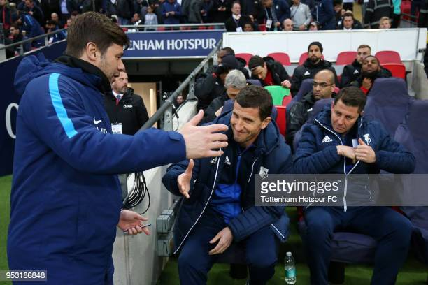 Mauricio Pochettino Manager of Tottenham Hotspur shakes hands with Javi Gracia Manager of Watford ahead of the Premier League match between Tottenham...
