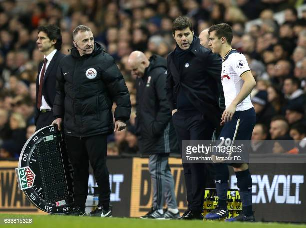 Mauricio Pochettino Manager of Tottenham Hotspur speaks to Harry Winks of Tottenham Hotspur as he comes on during the Premier League match between...
