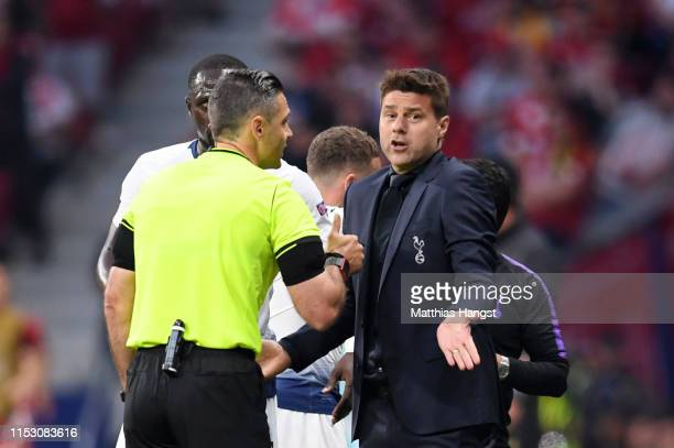 Mauricio Pochettino Manager of Tottenham Hotspur speaks to match referee Damir Skomina during the UEFA Champions League Final between Tottenham...