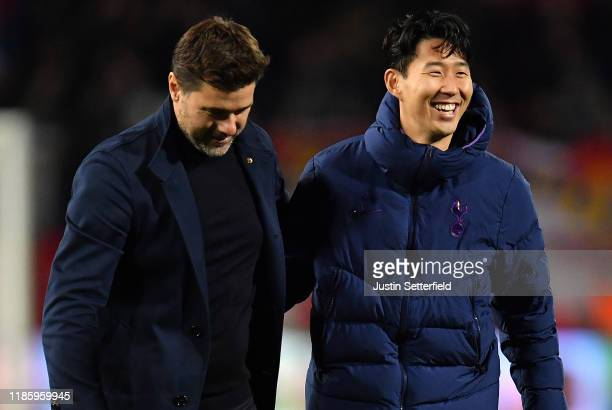 Mauricio Pochettino Manager of Tottenham Hotspur speaks with HeungMin Son of Tottenham Hotspur after the UEFA Champions League group B match between...