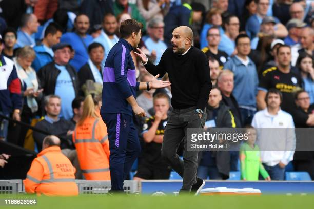 Mauricio Pochettino Manager of Tottenham Hotspur speaks with Pep Guardiola Manager of Manchester City after the final whistle during the Premier...