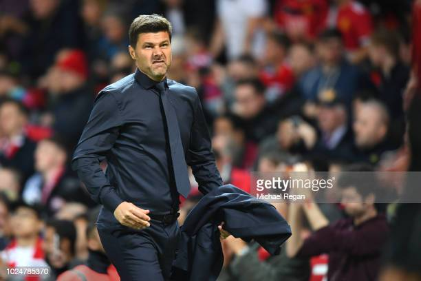 Mauricio Pochettino, manager of Tottenham looks on during the Premier League match between Manchester United and Tottenham Hotspur at Old Trafford on...