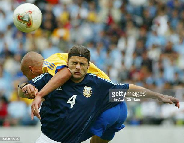 Mauricio Pochettino of Argentina and Henrik Larsson of Sweden compete for the ball during the FIFA World Cup Korea/Japan Group F match between Sweden...