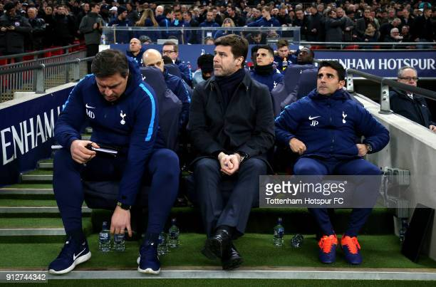 Mauricio Pochettino of Tottenham Hotspur looks on from the dugout prior to the Premier League match between Tottenham Hotspur and Manchester United...