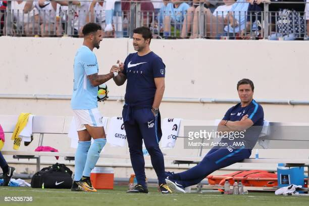 Mauricio Pochettino the head coach / manager of Tottenham Hotspur gives the ball to Kyle Walker of Manchester City during the International Champions...