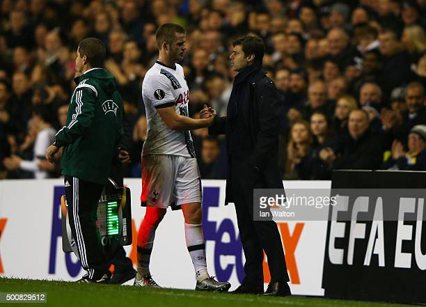 Mauricio Pochettino the manager of Spurs shakes hands with the injured Eric Dier of Spurs as he leaves the pitch during the UEFA Europa League Group...