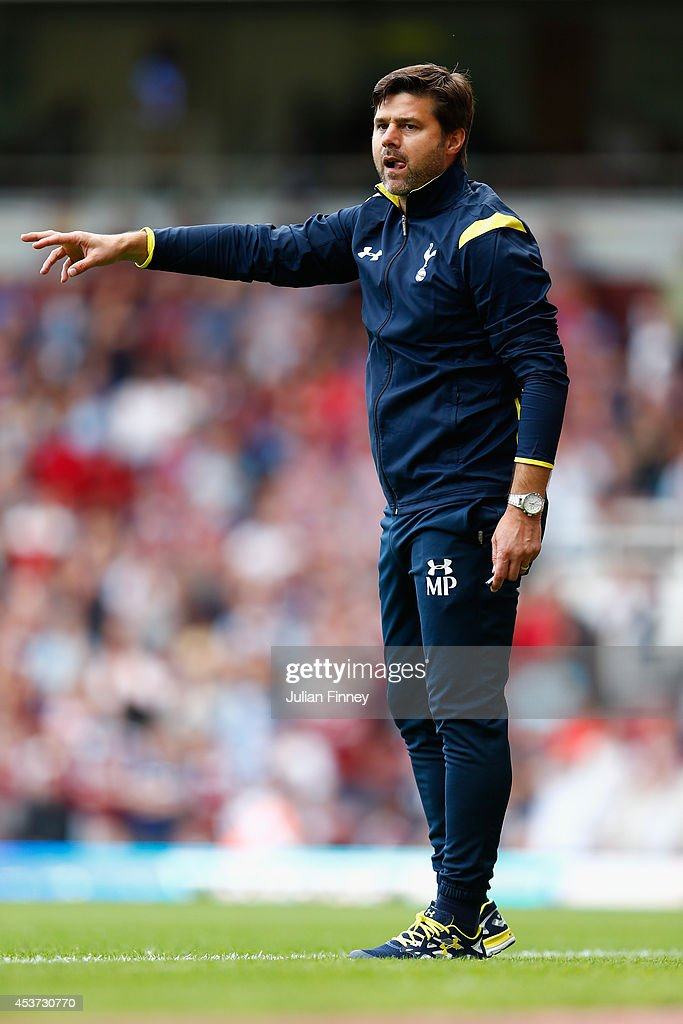 Mauricio Pochettino the Spurs manager directs his side during the Barclays Premier League match between West Ham United and Tottenham Hotspur at Boleyn Ground on August 16, 2014 in London, England.