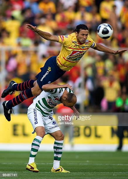 Mauricio Romero of Monarcas Morelia vies for the ball with Carlos Ochoa of Santos Laguna during their match as part of the 2009 Opening Tournament in...