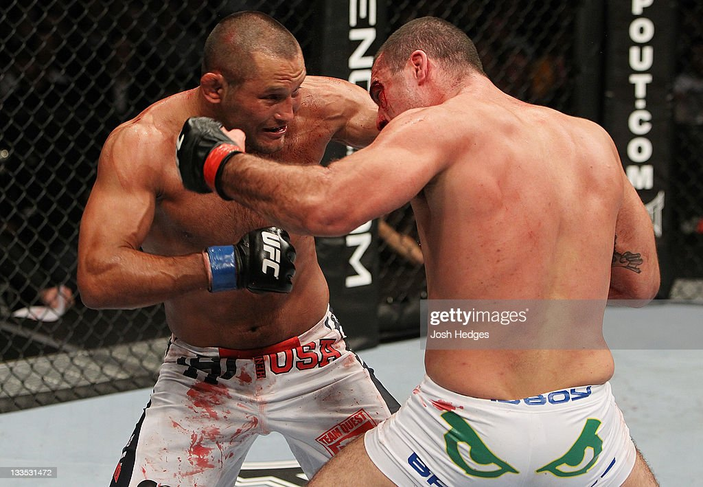Mauricio Rua and Dan Henderson exchange punches during an UFC Light Heavyweight bout at the HP Pavillion on November 19, 2011 in San Jose, California.