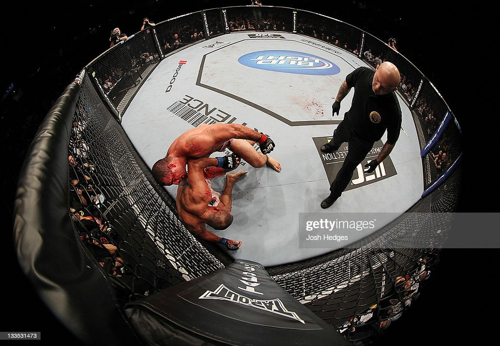 Mauricio Rua (top) attacks Dan Henderson (bottom) up against the righ during an UFC Light Heavyweight bout at the HP Pavillion on November 19, 2011 in San Jose, California.