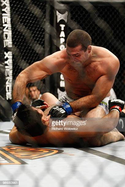 Mauricio 'Shogun' Rua punches Lyoto Machida in their light heavyweight bout at UFC 113 at Bell Centre on May 8 2010 in Montreal Quebec Canada