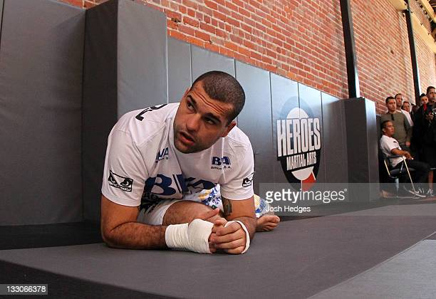 """Mauricio """"Shogun"""" Rua stretches before working out for the fans and media during the UFC 139 open workouts at the Heroes Martial Arts Gym on November..."""
