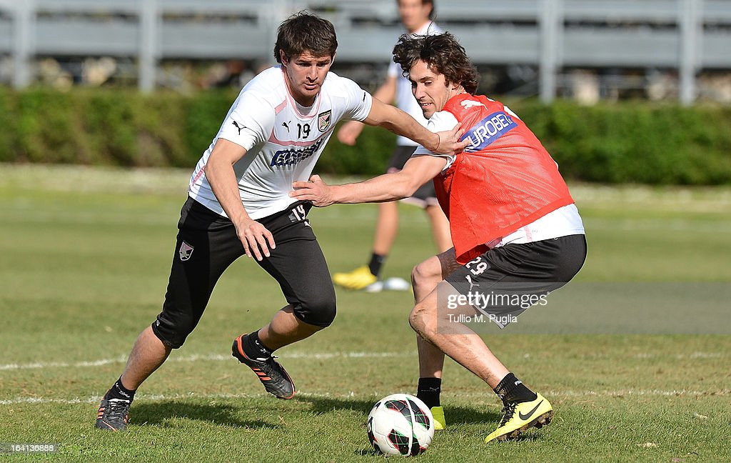 Mauricio Sperduti (L) and Santiago Garcia in action during a Palermo training session at Tenente Carmelo Onorato Sports Center on March 22, 2013 in Palermo, Italy.