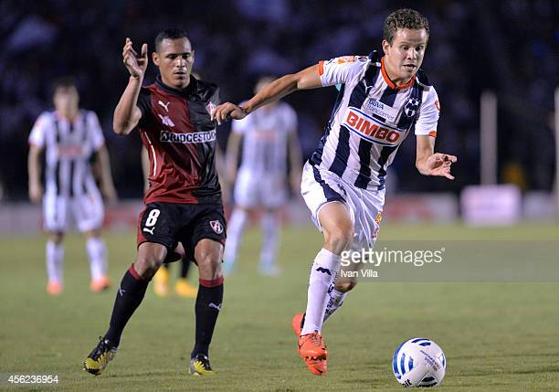 Mauricio Talancon of Monterrey struggles for the ball with Aldo Leao of Atlas during a match between Monterrey and Atlas as part of 10th round...