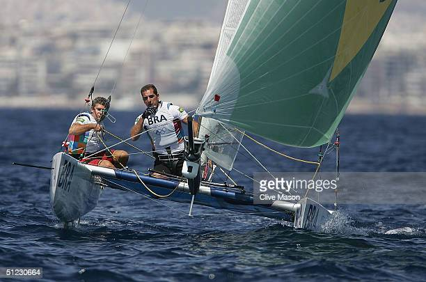 Maurico Santa Cruz Oliveira and Joao Carlos Jordao of Brazil in action in the open multihull tornado finals race on August 28 2004 during the Athens...