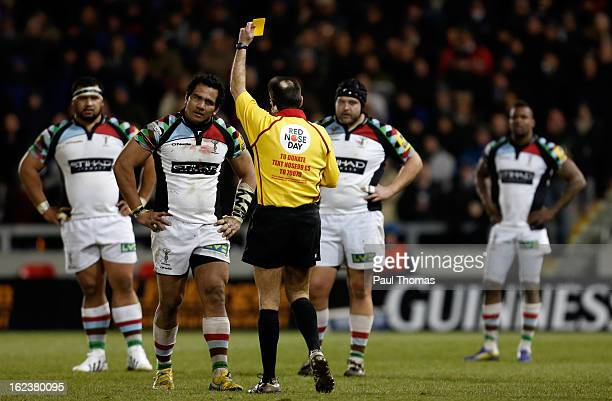 Maurie Fa'asavalu of Harlequins receives a yellow card from referee Martin Fox during the Aviva Premiership match between Sale Sharks and Harlequins...