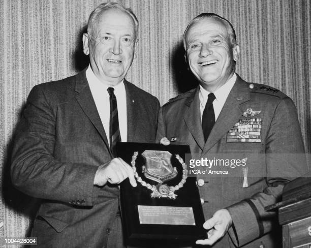 LOS ANGELES CA Maurie Luxford receives an award with the United States Air Force Crest from Lieutenant General Archie Old Jr Commander 15th Air Force...