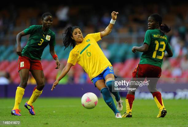 Maurine of Brazil in action with Ajara Nchout and Claudine Meffometou during the First Round Women's Football Group E Match of the London 2012...