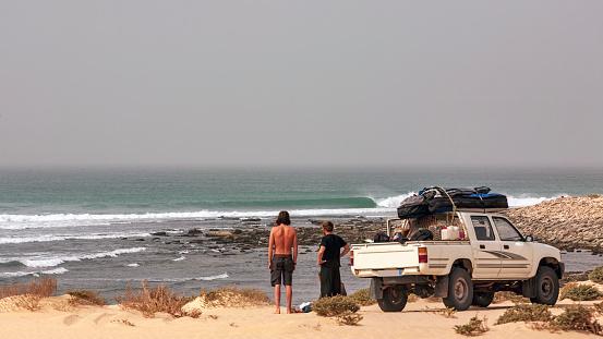 Mauritania, surfers and ocean waves - gettyimageskorea