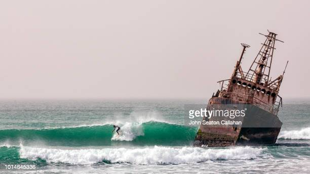 mauritania, surfing in the atlantic ocean - ship wreck stock pictures, royalty-free photos & images