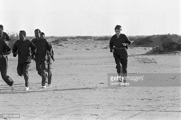 Mauritanian Army Training En Mauritanie en novembre 1977 Mme la présidente Mariem OULD DADDAH participe à l'entrainement militaire sur la plage d'El...