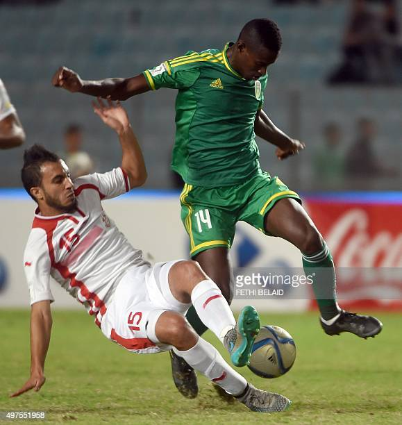 Mauritanian forward Mohamed Dellah Yaly vies with Tunisian forward Mohamed Ali Moncer during their FIFA World Cup 2018 qualifying football match at...