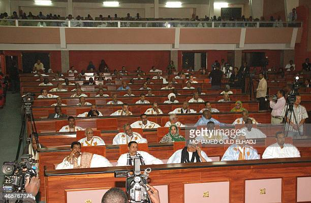 Mauritanian members of parliament attend the inaugural session of the Mauritania's National Assembly on January 29 2014 in Nouakchott Former...