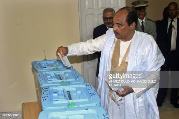 Mauritanian President Mohamed Ould Abdel Aziz casts his vote on September 1 2018 at a polling station in Nouakchott for the country's legislative...
