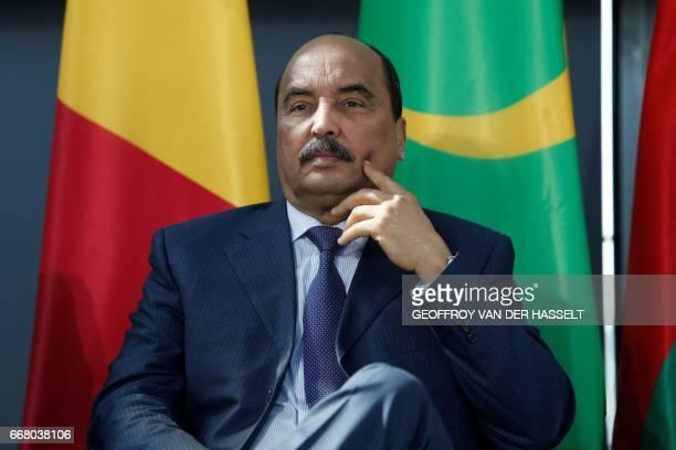 Mauritanian President Mohamed Ould Abdel Aziz listens during the exhibition Tresors de l'Islam en Afrique De Tombouctou à Zanzibar Islam's treasures...