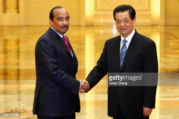 Mauritanian President Mohamed Ould Abdel Aziz shakes hands during a meeting with Chinese President Hu Jintao at the Great Hall of the People on...