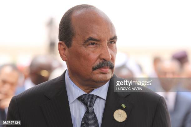 Mauritanian President Mohamed Ould Abdel Aziz waits for the arrival of the French President at Nouakchott airport on July 2 2018 The French President...