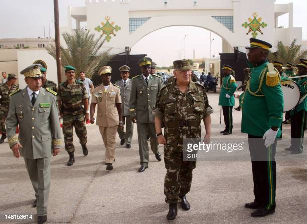 Mauritanian's Chief of Staff Division General Mohamed Ould Mohamed'Ahmed and Algeria's Chief of Staff General Ahmed Gaid Salem arrive for a meeting...