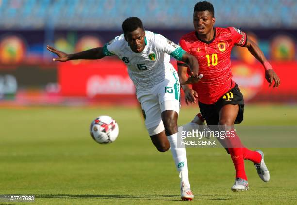 Mauritania's defender Bakary Ndiaye marks Angola's forward Gelson Dala during the 2019 Africa Cup of Nations Group E football match between...