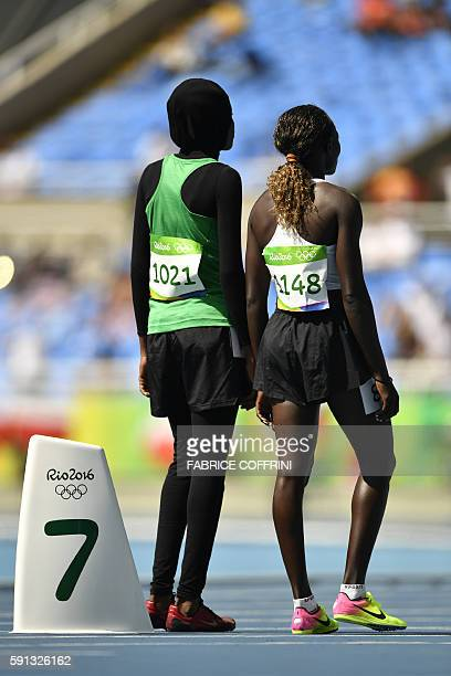Mauritania's Houleye Ba and Refugee OlympicTeam's Nathike Rose Lokonyen prepare to compete in the Women's 800m Round 1 during the athletics event at...