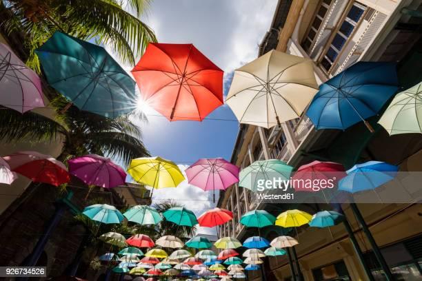 mauritius, port louis, caudan waterfront, umbrella square - port louis stock photos and pictures