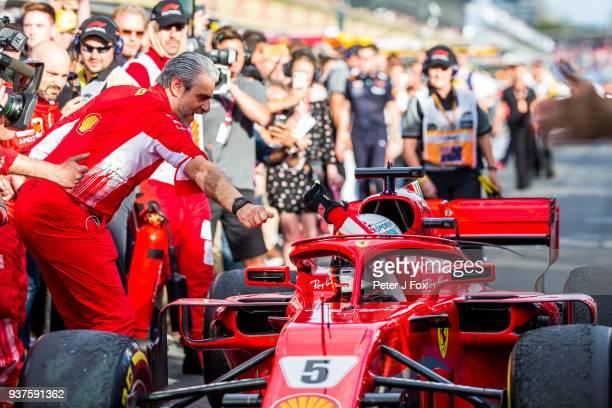 Maurizio Arrivabene Ferrari Team Principal congratulates Sebastian Vettel of Ferrari and Germany during the Australian Formula One Grand Prix at...