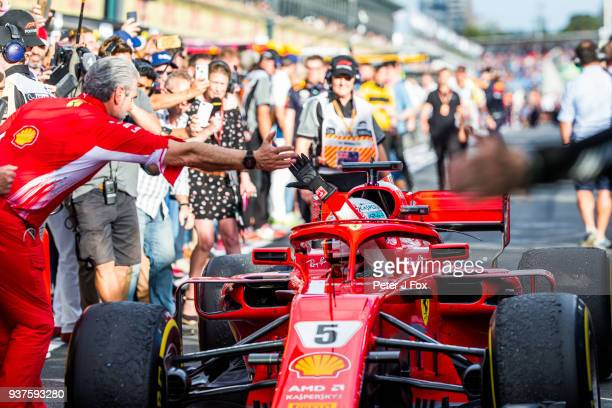 Maurizio Arrivabene Ferrari Team Principal congratulates Sebastian Vettel of Ferrari and Germany during the Australian Formula One Grand Prix at...