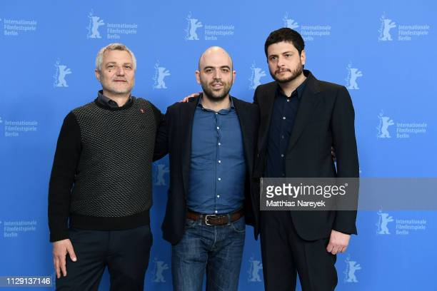 Maurizio Braucci Roberto Saviano and Claudio Giovannesi pose at the Piranhas photocall during the 69th Berlinale International Film Festival Berlin...