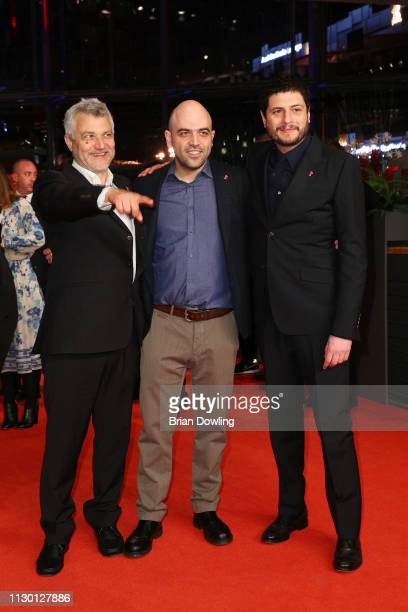Maurizio Braucci Roberto Saviano and Claudio Giovannesi pose prior to the closing ceremony of the 69th Berlinale International Film Festival Berlin...