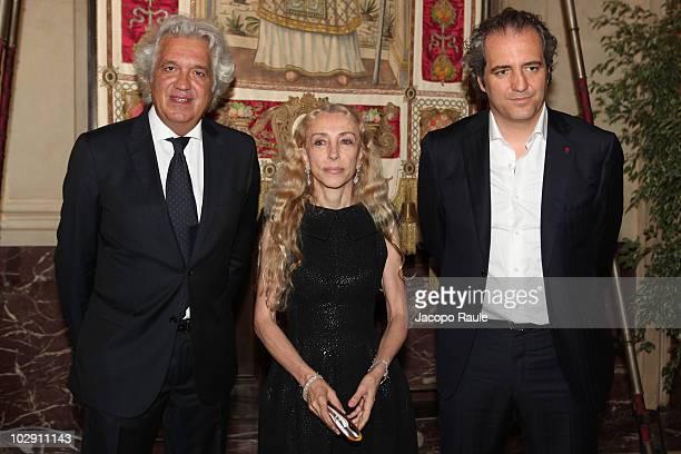 Maurizio Cadeo Franca Sozzani Giovanni Terzi attend Vogue Fashion's Night Out press conference on July 15 2010 in Milan Italy