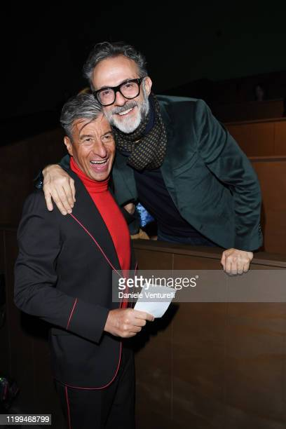 Maurizio Cattelan and Massimo Bottura are seen on Gucci Front Row during Milan Menswear Fashion Week Fall/Winter 2020/21 on January 14 2020 in Milan...