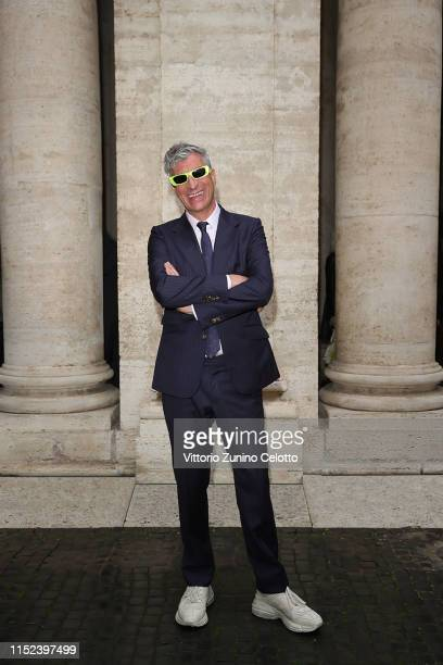 Maurizio Cattelan arrives at the Gucci Cruise 2020 at Musei Capitolini on May 28 2019 in Rome Italy