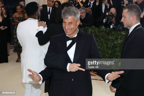 Maurizio Cattelan attends Heavenly Bodies Fashion the Catholic Imagination the 2018 Costume Institute Benefit at Metropolitan Museum of Art on May 7...