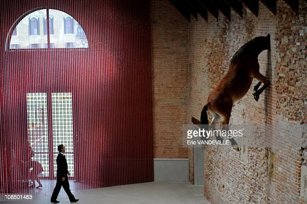 Maurizio Cattelan ' Untitled ' headless body of an actual stuffed horse suspended high in the air against a wall French billionaire Francois Pinault...