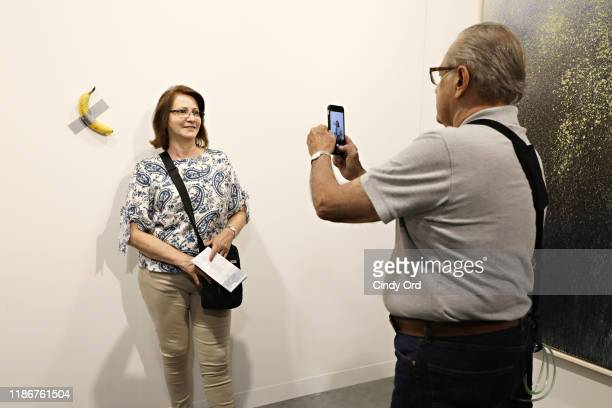 """Maurizio Cattelan's """"Comedian"""" presented by Perrotin Gallery and on view at Art Basel Miami 2019 at Miami Beach Convention Center on December 6, 2019..."""