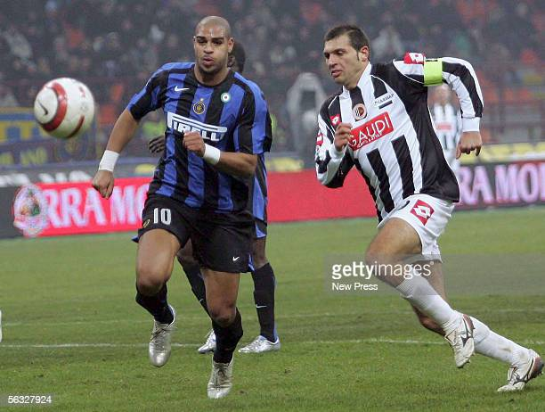 Maurizio Domizzi of Ascoli competes with Adriano of Inter during the Serie A match between Inter Milan and Ascoli at the San Siro stadium on December...