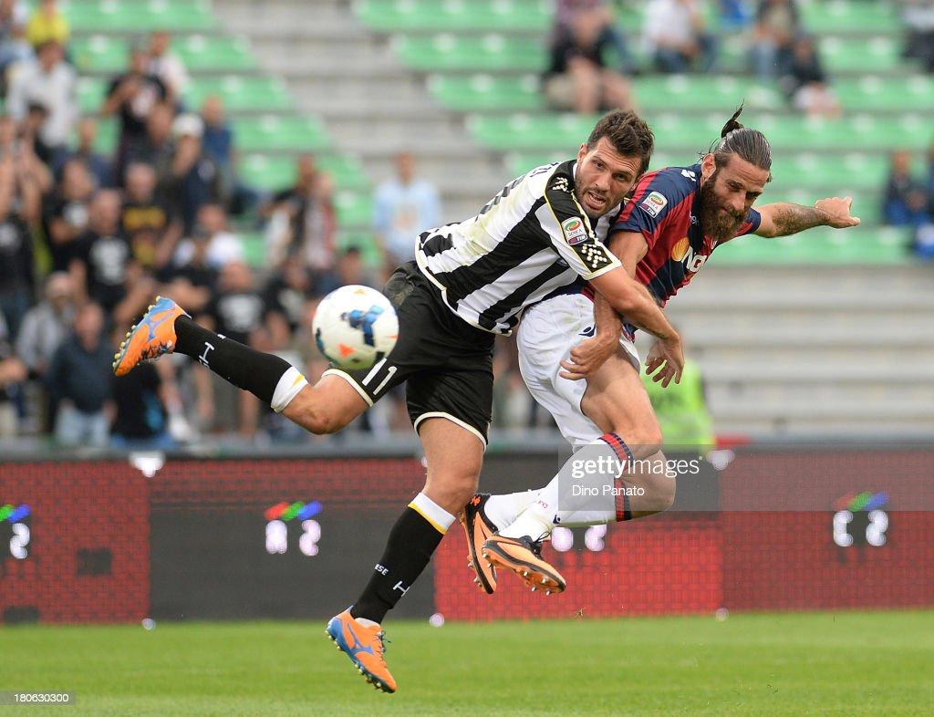 Maurizio Domizzi (L) of Udinese Calcio competes with Davide Moscardelli Bologna FC during the Serie A match between Udinese Calcio and Bologna FC at Stadio Friuli on September 15, 2013 in Udine, Italy.