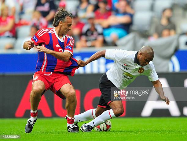 Maurizio Gaudino of FCB AllStars challenges Quinton Fortune of ManUtd Legends during the friendly match between FC Bayern Muenchen AllStars and...